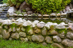 Natural stone landscaping. With water in a garden Stock Photos
