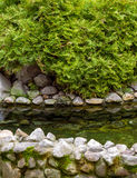 Natural stone landscaping. With water in a garden Royalty Free Stock Photo