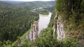 Natural stone pillars. At Usva river, Perm region, Russia. Summer royalty free stock photo