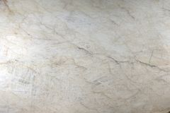 Natural stone polished white quartzite with cracks and streaks.  royalty free stock photography