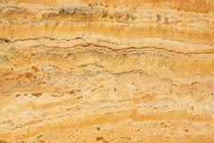 A natural stone, a polished yellow marble called Travertino Giallo royalty free stock photography
