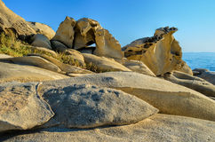 Natural stone sculpture 1. Natural stone sculpture - large rocks of various shapes on Carydi beach, Sithonia, Greece Royalty Free Stock Photography