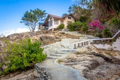 Natural stone stairs leading to house on  cliff Stock Image