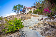 Natural stone stairs leading to house on  cliff Royalty Free Stock Images