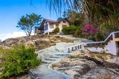 Natural stone stairs leading to house on  cliff Stock Photo
