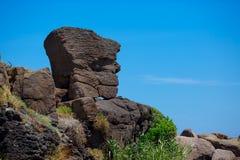 Natural stone statue in Castelsardo port, Sardinia Royalty Free Stock Photos