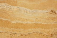 Natural stone travertine yellow color with an interesting pattern and stripes, called Travertino Giallo