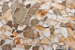 Natural stone wall. Wall covered in natural stone of irregular shapes Stock Image
