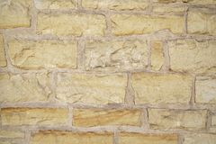 Natural stone wall background texture Stock Photography