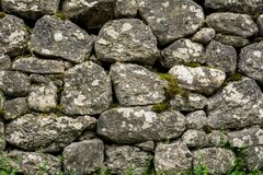 Natural stone wall with vegetation Royalty Free Stock Image