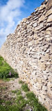Natural stone wall in the sunshine Stock Photo
