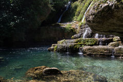 Natural Stone Waterfalls of Navacelles with Clear Water Pond Royalty Free Stock Photos