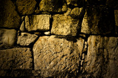 Natural stones are folded in wall. Background Stock Image