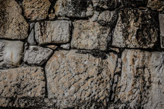 Natural stones are folded in wall. Background Royalty Free Stock Photo