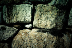 Natural stones are folded in wall. Background Royalty Free Stock Photos