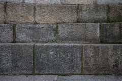 Natural stones are folded in wall. Background Stock Images