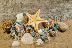 Natural stones necklace and sea objects composition. Royalty Free Stock Photography