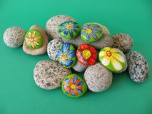 Natural stones with painted flowers Stock Photo