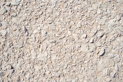 Natural stones pile on sand texture background Royalty Free Stock Images