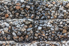 Natural stones in retain A wire mesh gabion wall Stock Photo