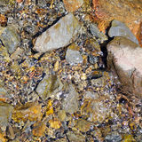 Natural stones in the river Stock Photos
