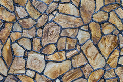 Natural stones. Natural stone for construction. Texture facing surface of natural stone with black seams Stock Photography