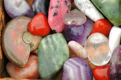 Natural stones variety. A lot of colorful faceted minerals: nephrites, quartz, rhodonite and other Stock Photo