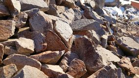 Natural stones and winter sunny day royalty free stock photo
