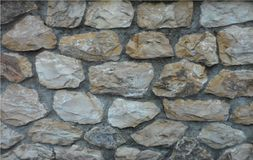 Natural stonewall in Prato Italy. A wall made with large pieces of natural stone in the city of Prato in Tuscany, Italy Stock Photos
