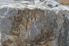 The natural structure of a large hewn stone.  Stock Image