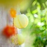 Natural summer decoration. Beautiful garden decoration with paper lanterns Stock Photo