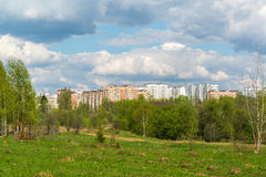 Natural summer landscape with city in distance Stock Photo