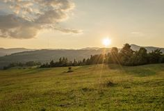 Natural summer landscape. Sunset over mountains royalty free stock photo