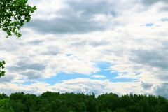 A natural summer weather background with a cloudy blue cloudy sk Stock Photography