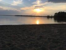 Sandy lake under sunset stock images