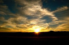 Sun Rays Gleam as it Sets royalty free stock photo