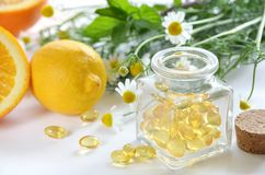 Natural supplement. Capsules with fruits and herbs Royalty Free Stock Photography