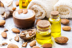 Natural sweet almond essential oil for beauty and spa. Healthy lifestyle concept. Natural sweet almond essential oil, essence in glass bottle with sea salt on a stock photos
