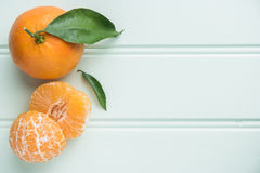 Natural sweet clementines on rustic table from above Royalty Free Stock Photography