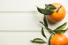 Natural sweet clementines on rustic table from above Royalty Free Stock Images