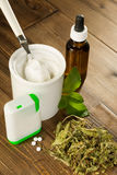 Natural sweetener stevia. Powder stevia and liquid, dried and tablet forms on a wooden table Stock Photos
