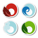Natural symbols - fire, air, water, earth - nature circular stickers with flame, bubble air, wave water and leaf. Illustration Stock Photography