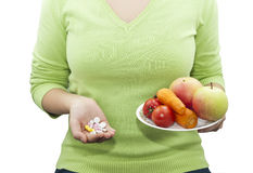 Natural and synthetic vitamins. Choice between natural and synthetic vitamins. Concept Royalty Free Stock Photography