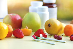 Natural or synthetic vitamins ?. (healthy eating Stock Photography