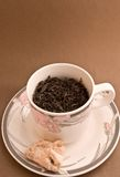 Natural tea. A cup of black tea with a cookie Stock Photos