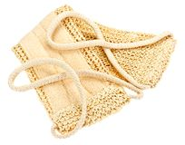 Natural textile bath sponge with rope handle Royalty Free Stock Photo