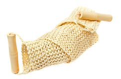Natural textile bath sponge with wooden handle Royalty Free Stock Photography