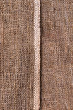 Natural texture of burlap with a white stripe as a background Royalty Free Stock Photo
