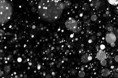 Natural texture of falling snow. Against the background of the night sky Royalty Free Stock Images