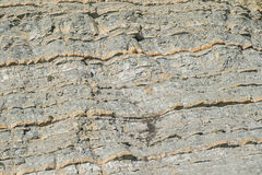 Natural texture of stone in a mountain on a cliff near the sea.  Royalty Free Stock Images